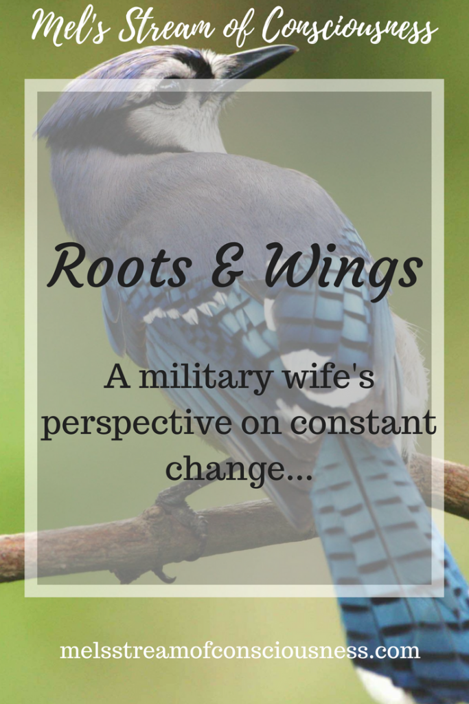 A bird has both wings and roots in his way.
